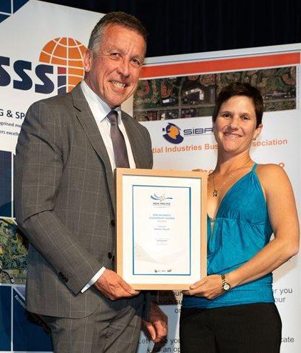 Karen Joyce receives her award from Bob Markham